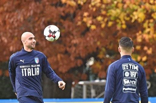 Italy's Simone Zaza, left, eyes the ball during a training session ahead of Friday's first leg of a World Cup playoff against Sweden, at the Coverciano training center, near Florence, Italy, Wednesday, Nov. 9, 2017. Italy forward Simone Zaza injured his left knee in training on Thursday, a day before the first leg of a World Cup playoff against Sweden. (Maurizio Degl'Innocenti/ANSA via AP)