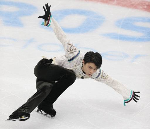 FILE - In this Oct. 21, 2017, file photo, Japan's Hanyu Yuzuru performs in his free program at the Rostelekom Cup ISU Grand Prix figure skating event in Moscow, Russia. Olympic champion Hanyu will be aiming for the top of the podium at the NHK Trophy, the fourth event of the International Skating Union's Grand Prix series, on Nov. 10, 11, 2017.