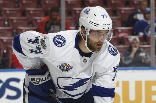 FILE - In this Sept. 28, 2017, file photo, Tampa Bay Lightning defenseman Victor Hedman (77) prepares for a face-off against the Florida Panthers during the first period of an NHL preseason hockey game, in Sunrise, Fla. New NHL faceoff violation enforcement has pressed more defensemen into taking draws this season. Like position players pitching, defensemen taking faceoffs after not practicing is a rare challenge.