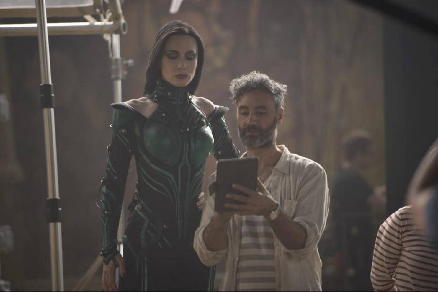 "Director Taika Waititi consults with Cate Blanchett on the set of ""Thor: Ragnarok."""