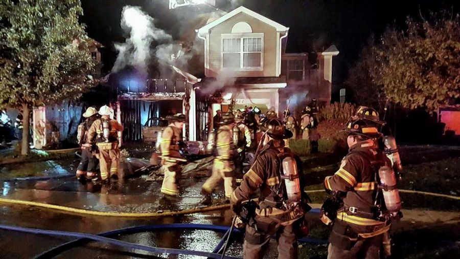 Crews responded to a garage fire in the 400 block of Mill Street in Batavia Friday night that was later upgraded to a structure fire. No one was injured and the blaze damaged four townhouse units.