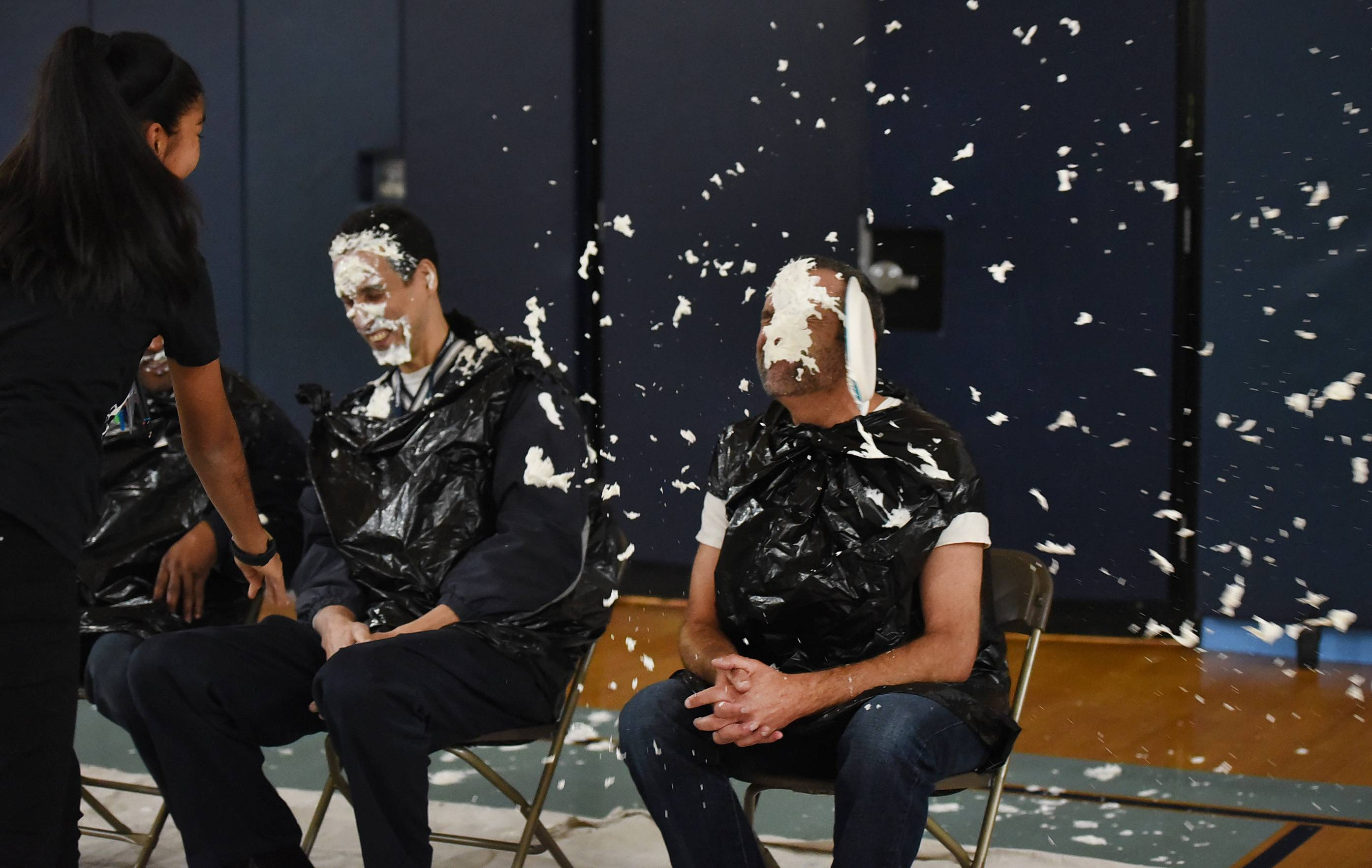 Ximena Bermudez blasts Principal Jeff Smith with a pie at the end of an assembly at Canton Middle School in Streamwood in a Veterans Day fundraiser for Arlington Heights-based military charity Salute, Inc. After the fun was over, veterans and active duty personnel met with students in their classrooms.