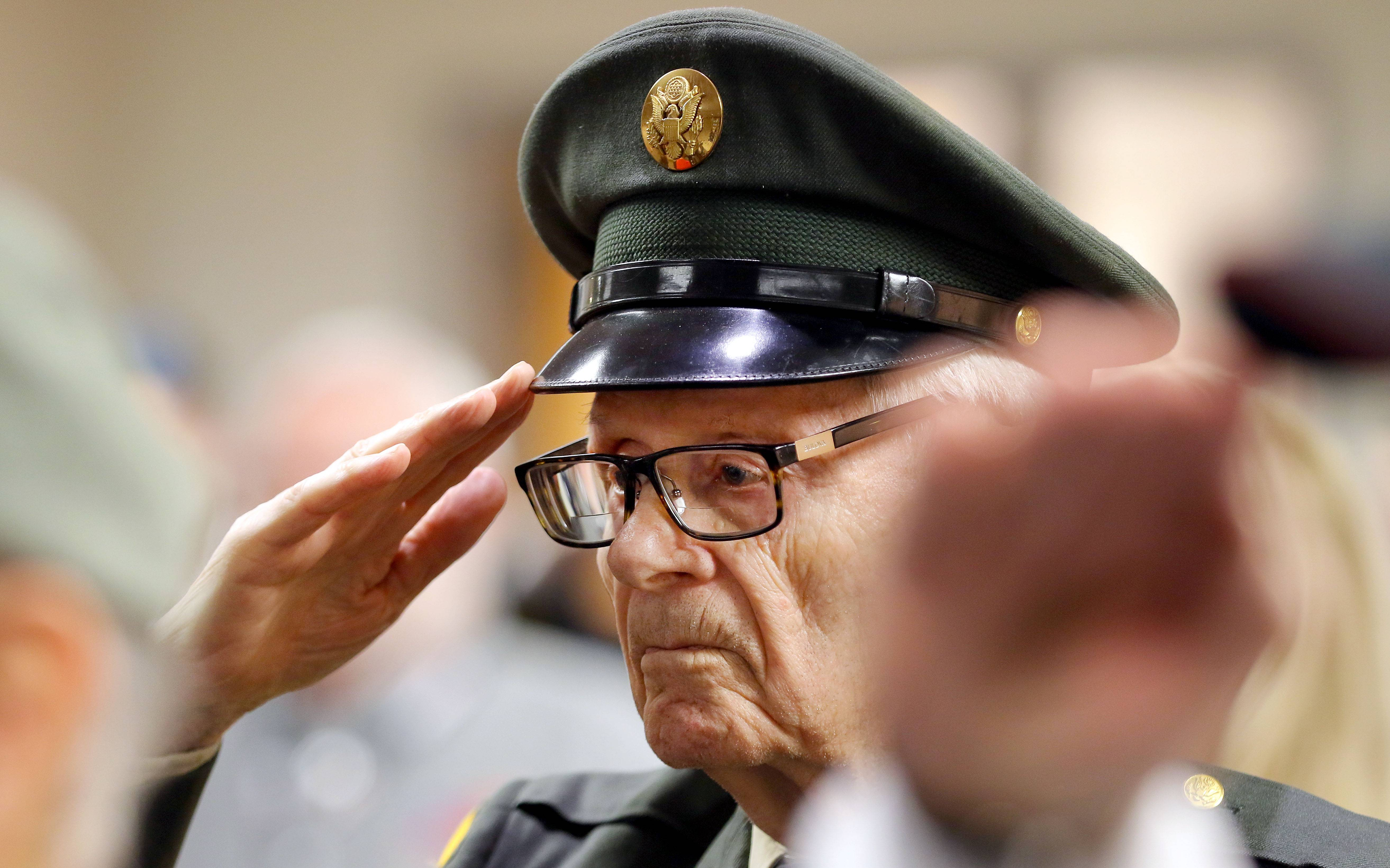 Veteran Orval Kolden of Lake Forest salutes during a Veterans Day ceremony at the College of Lake County Friday in Grayslake. Kolden served in the Army from 1946-1974.