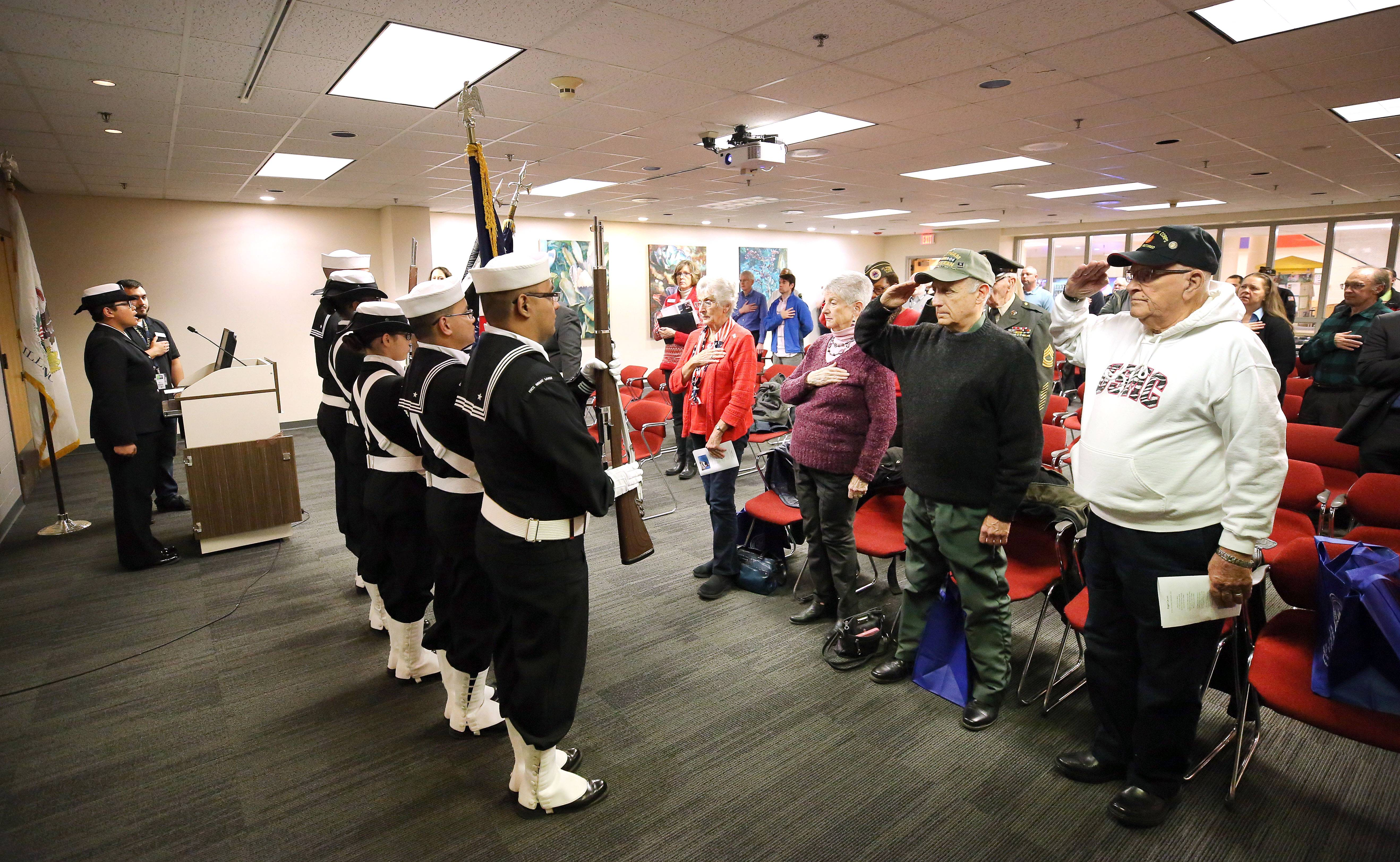 Steve Lundy/slundy@dailyherald.comColor Guard from Naval Station Great Lakes present the colors during a Veterans Day ceremony at the College of Lake County Friday in Grayslake.