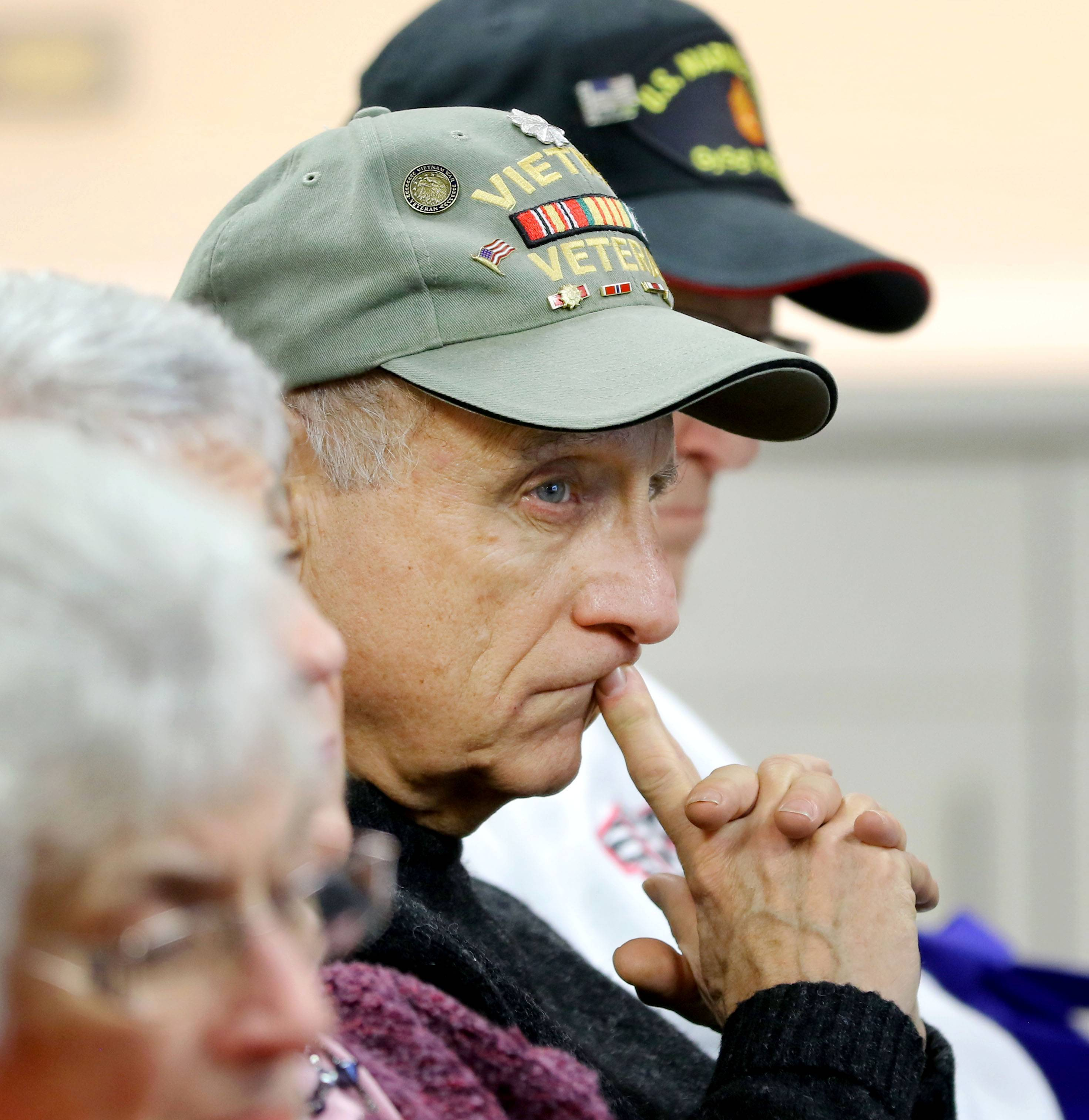 Army veteran George Duberstein of Haineville listens to the keynote address during a Veterans Day ceremony at the College of Lake County Friday in Grayslake. Duberstein served two tours of duty in Vietnam.