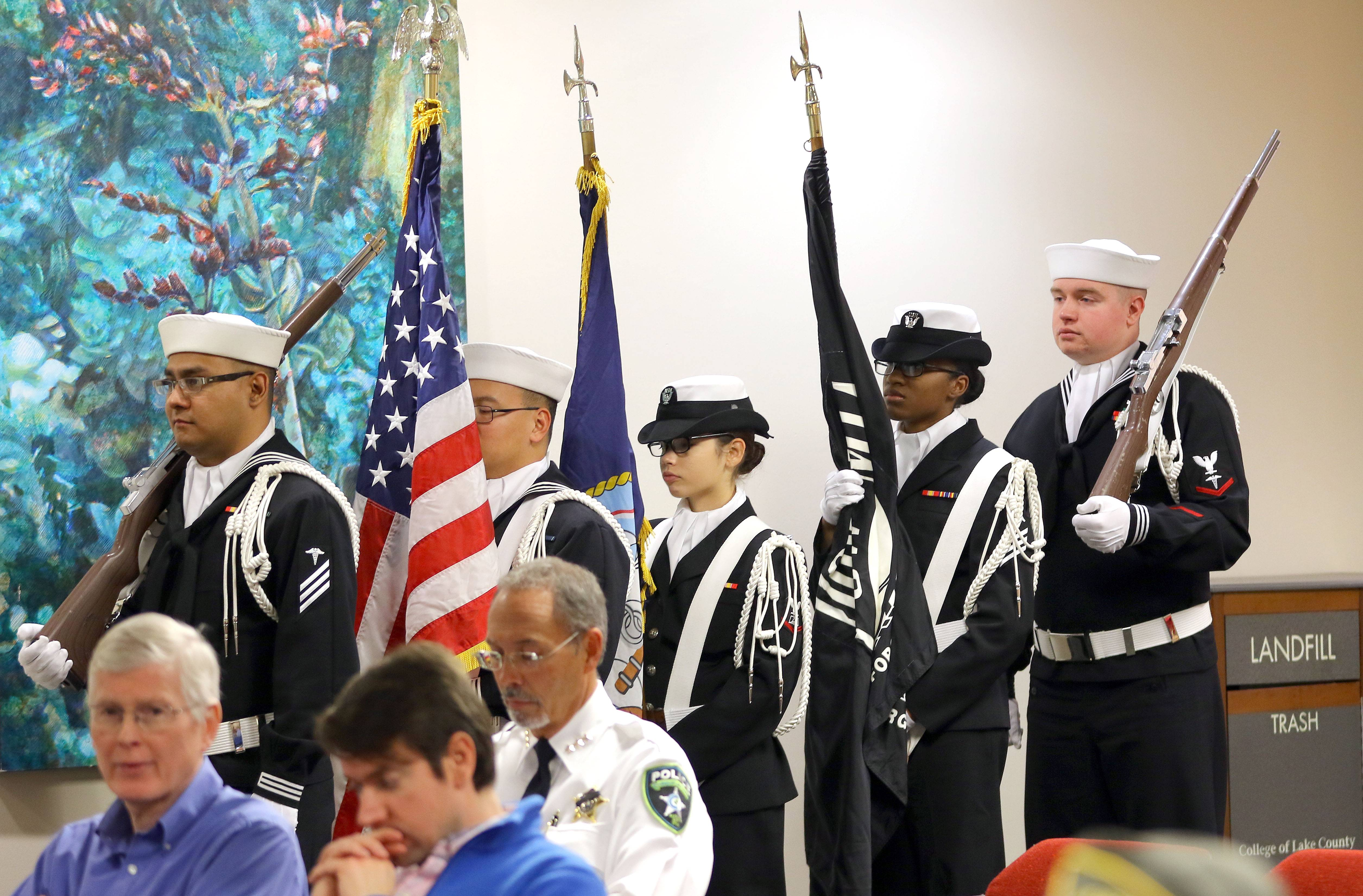 Steve Lundy/slundy@dailyherald.comColor Guard from Naval Station Great Lakes march in during a Veterans Day ceremony at the College of Lake County Friday in Grayslake.