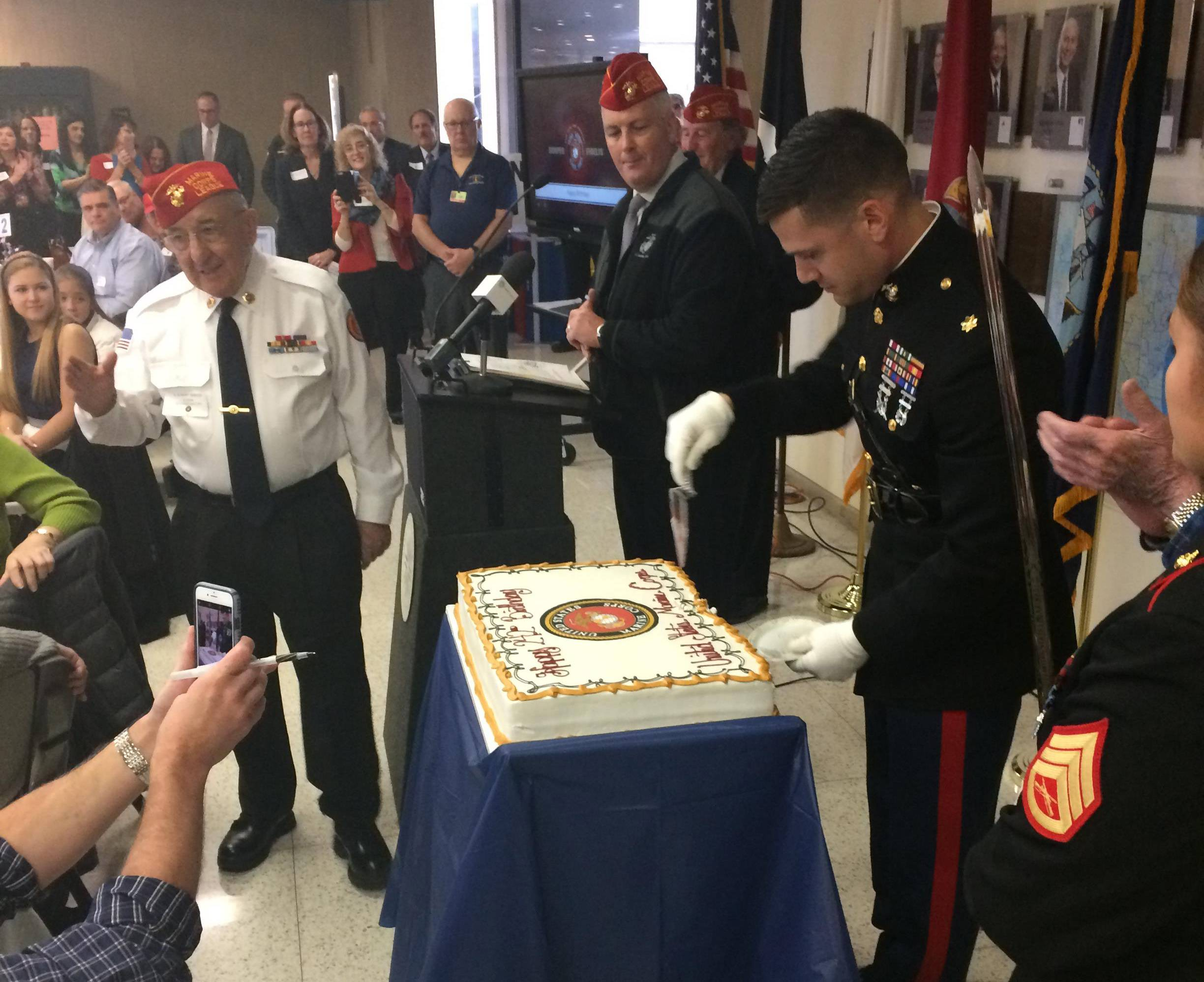 A Marine cuts a birthday cake Friday in honor of Veterans Day at the Lake County courthouse in Waukegan.