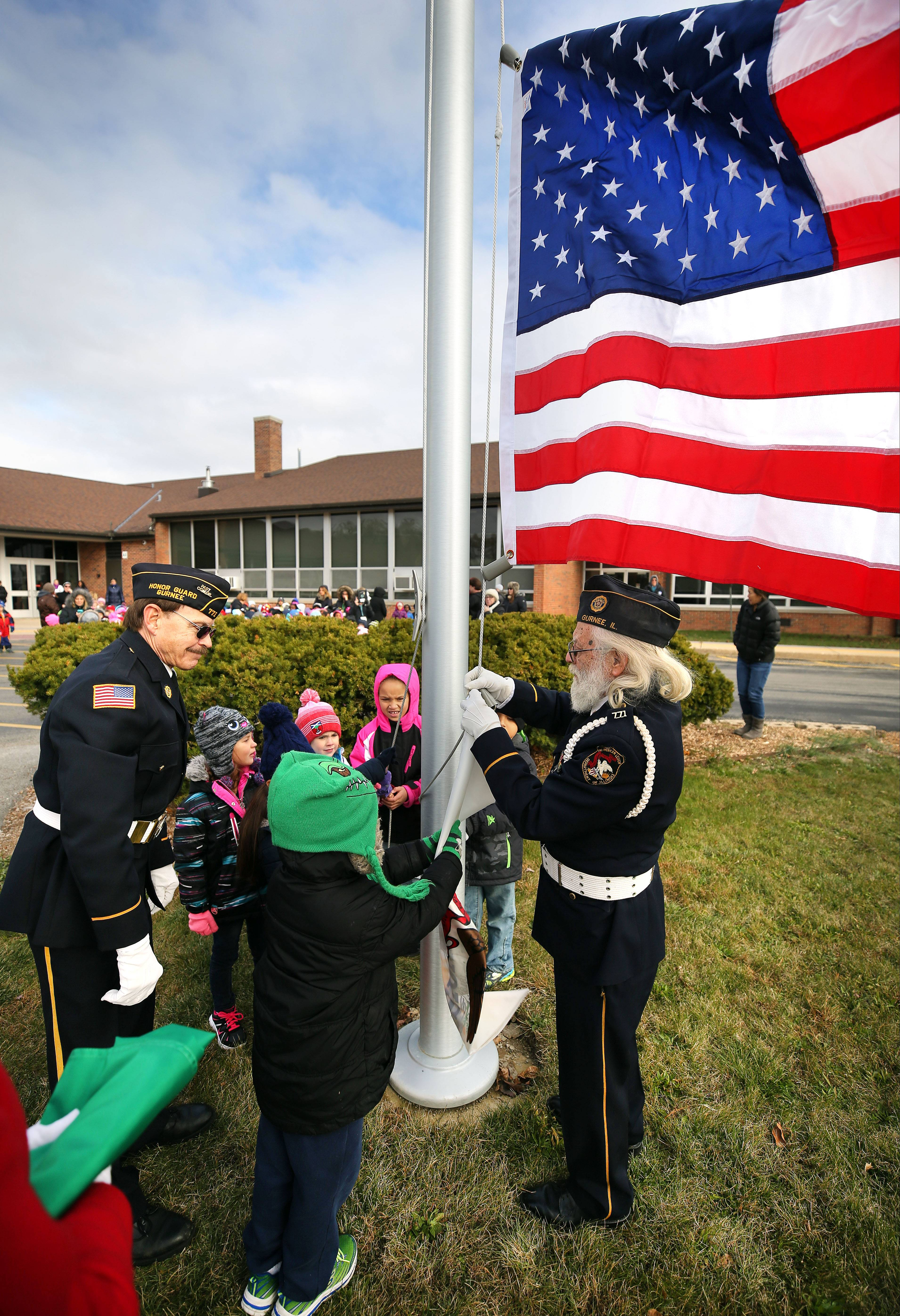 Gages Lake students salute veterans with new flagpole