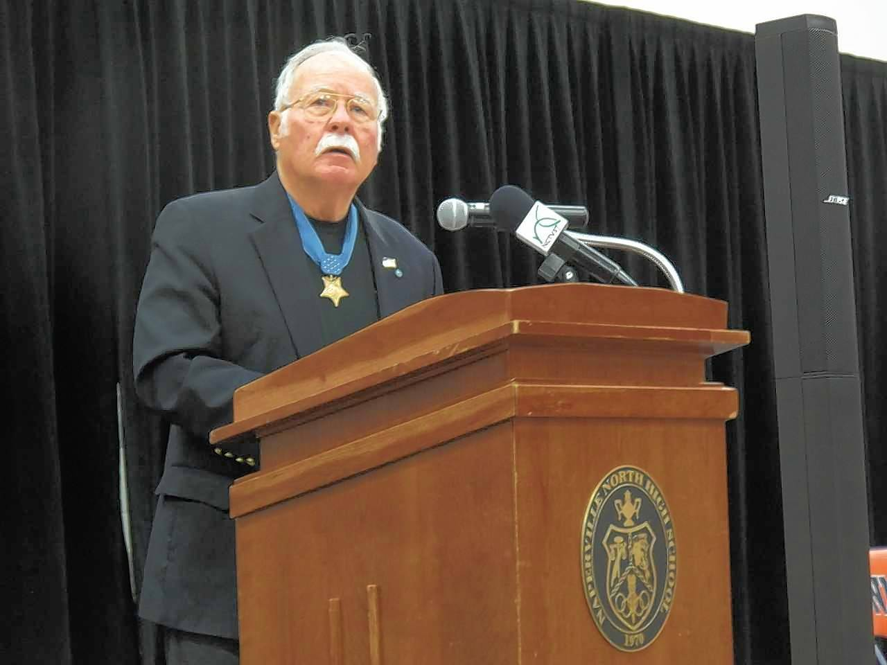 "Retired Marine Col. Harvey Barnum, a recipient of the Medal of Honor, speaks Friday at Naperville North High School. Barnum answered students' questions about his service during the Vietnam War and gave ""grandfatherly advice"" about setting high goals and never giving up"
