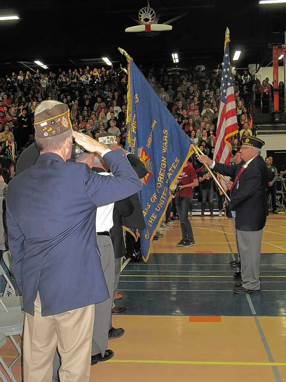 Naperville veterans stand on guard Friday at Naperville North High School during a Veterans Day assembly.