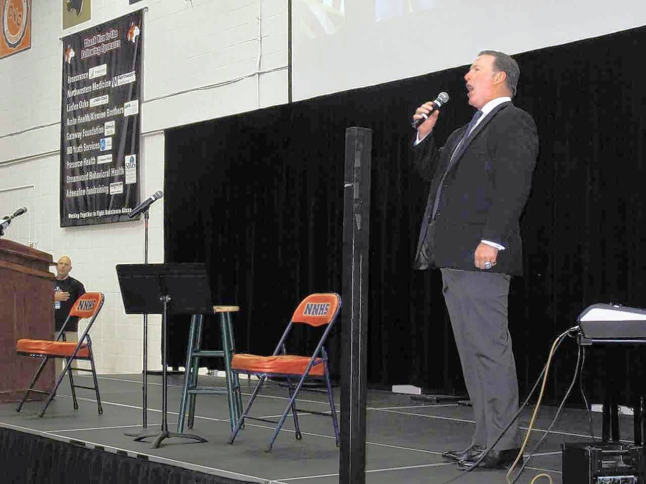 Jim Cornelison performs the national anthem Friday morning to open a Veterans Day assembly at Naperville North.