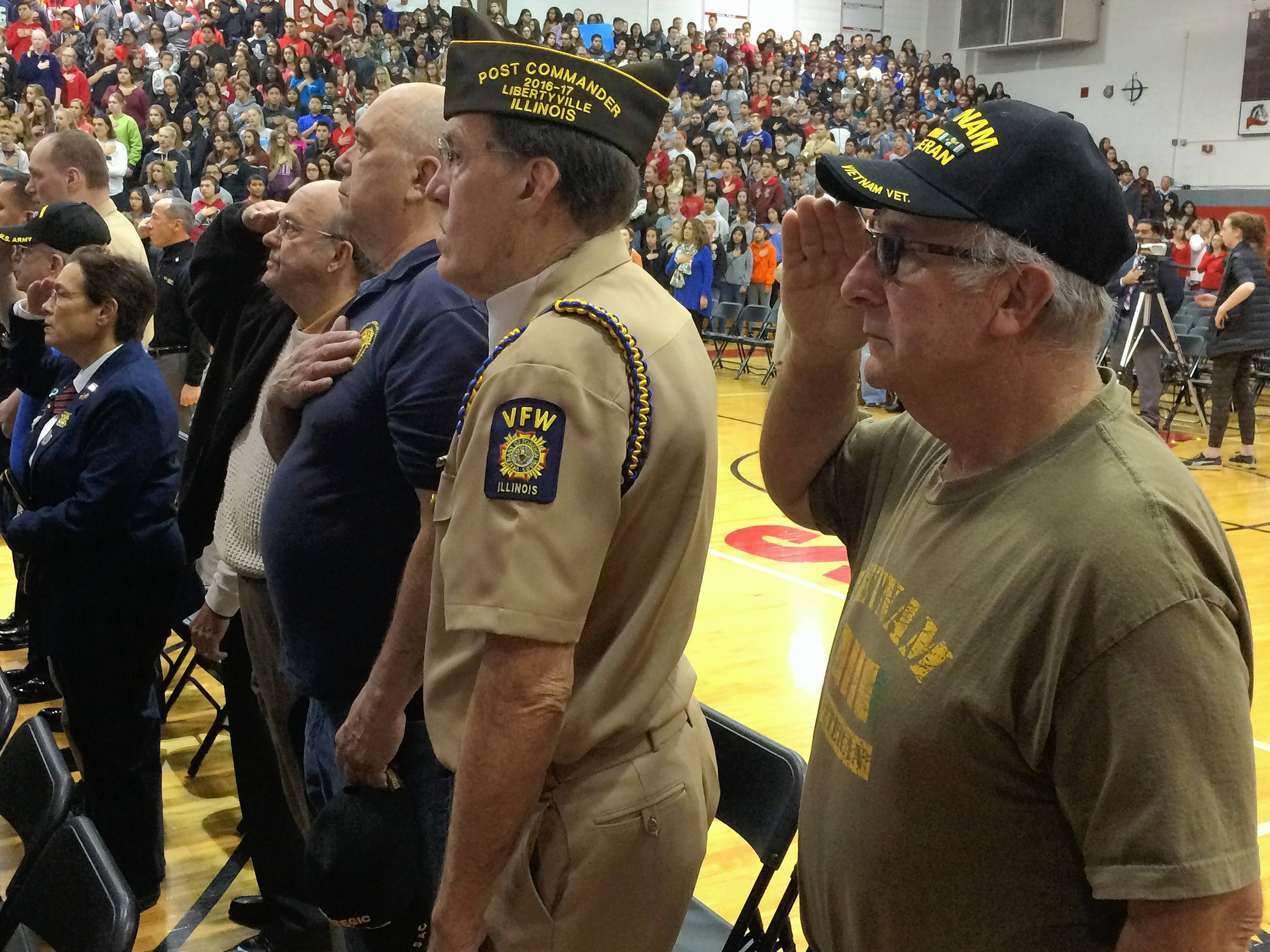 U.S. Navy veteran Steve Kaminsky, second from right, and U.S. Army veteran Salvatore Prato, right, were among those honored Friday at Mundelein High School.