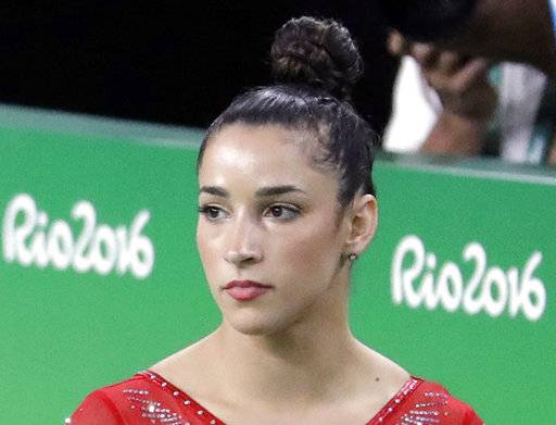 "FILE - In this Aug. 11, 2016, file photo, United States' Aly Raisman rests between apparatus' during the artistic gymnastics women's individual all-around final at the 2016 Summer Olympics in Rio de Janeiro, Brazil. Raisman says she is among the young women abused by a former USA Gymnastics team doctor. Raisman tells ""60 Minutes"" she was 15 when she was first treated by Dr. Larry Nassar, who spent more than two decades working with athletes at USA Gymnastics. He's now is in jail in Michigan awaiting sentencing after pleading guilty to possession of child pornography."