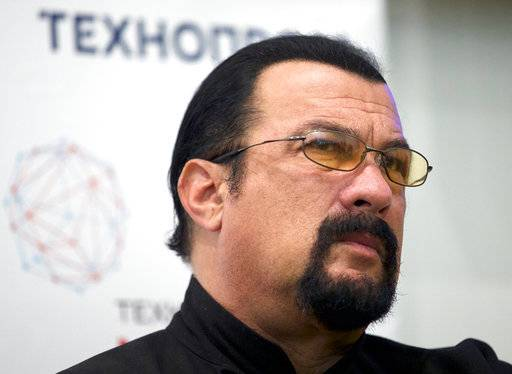 FILE - In this Sept. 22, 2015, file photo, actor Steven Seagal speaks at a news conference, while attending an opening ceremony for a research and development center in Moscow, Russia. Jenny McCarthy said on her Sirius XM show Nov. 9, 2017, that Seagal sexually harassed her during an audition in 1995. A Seagal spokesman has denied the McCarthy's accusations to The Daily Beast.