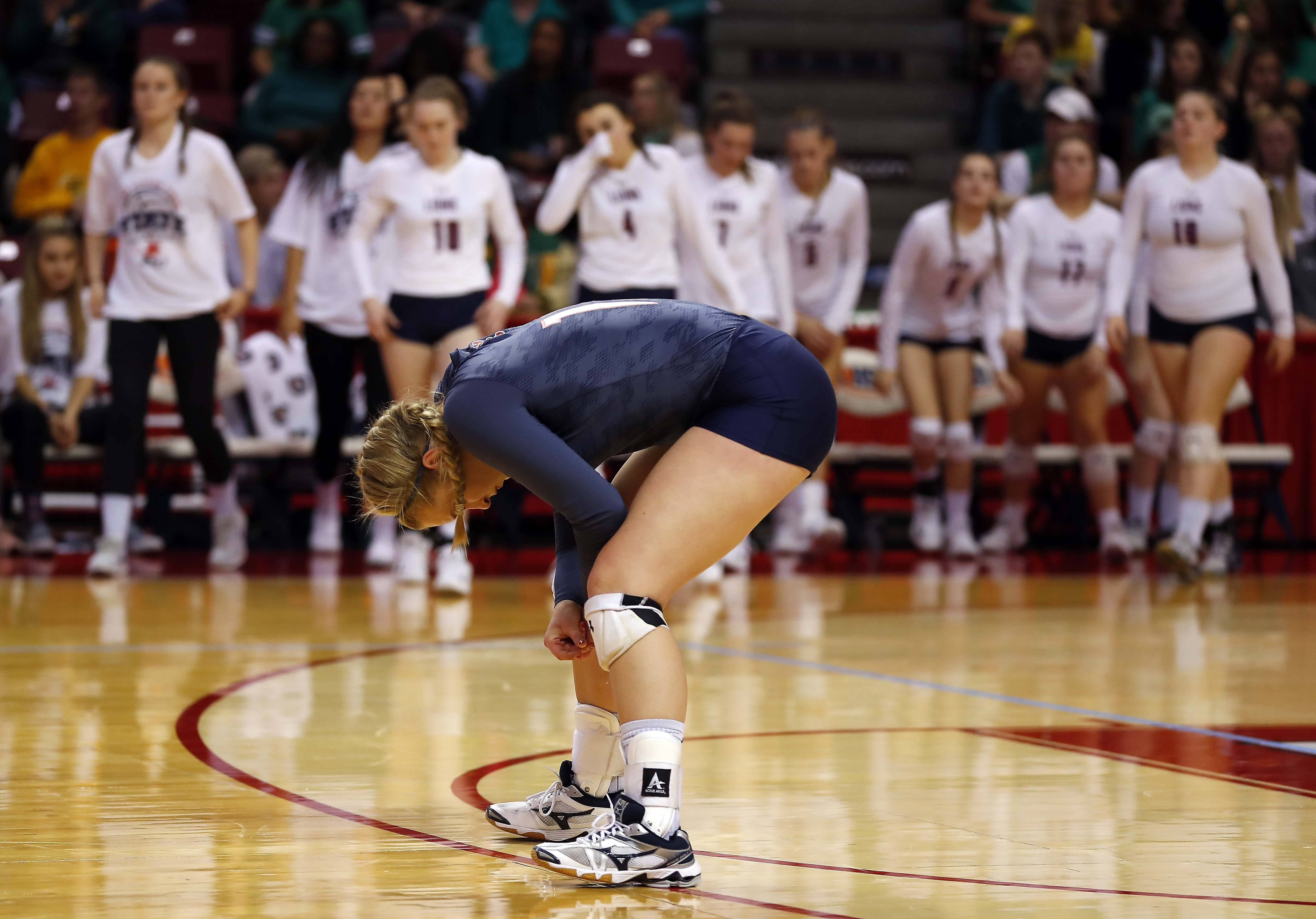 St. Viator's Carrie Leazer (15) reacts after their loss in the semifinals of the IHSA Class 3A state girls volleyball tournament at Redbird Arena in Normal.