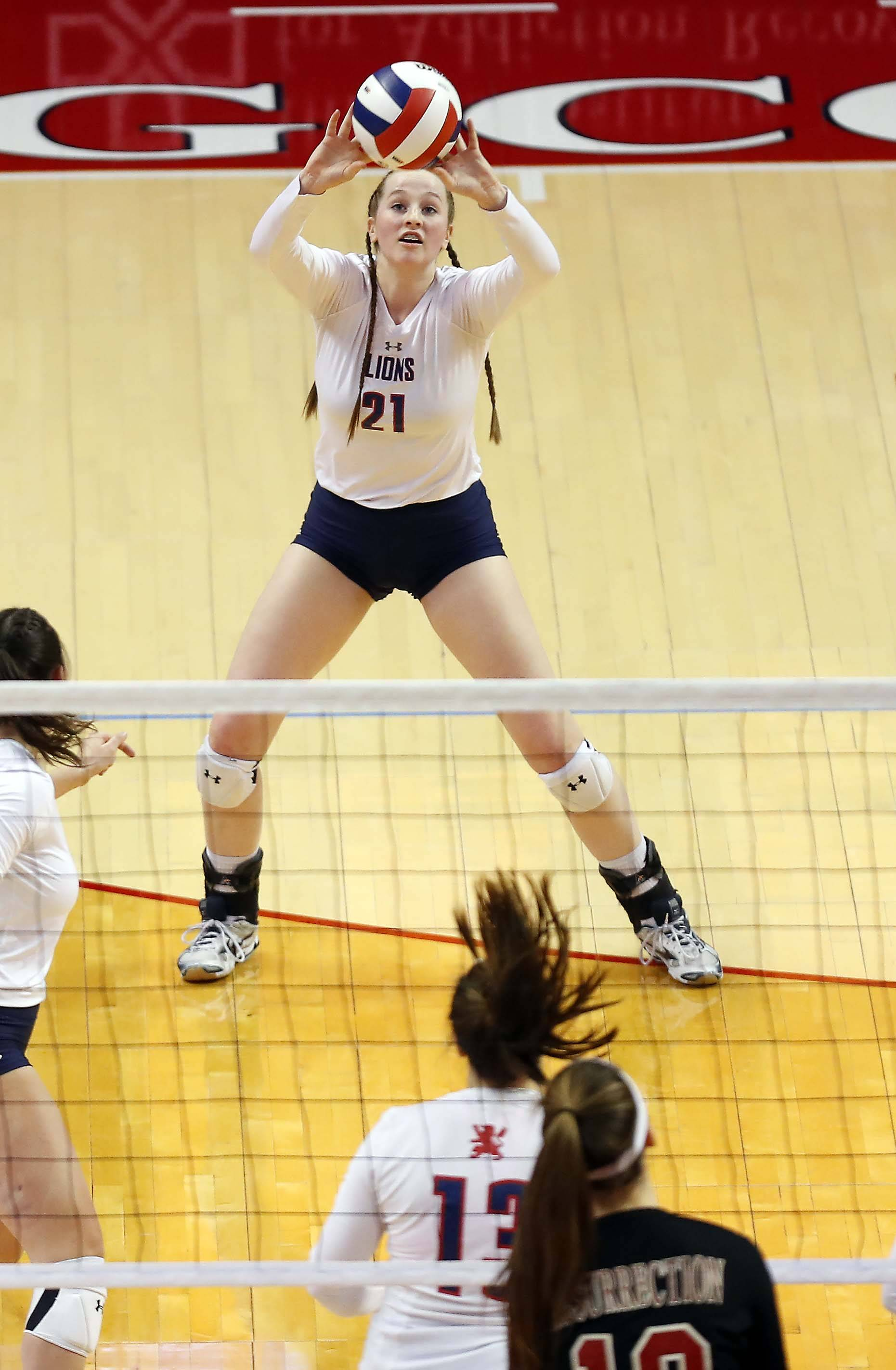 St. Viator's Catherine Hickey (21) returns a serve in the semifinals of the IHSA Class 3A state girls volleyball tournament at Redbird Arena in Normal.