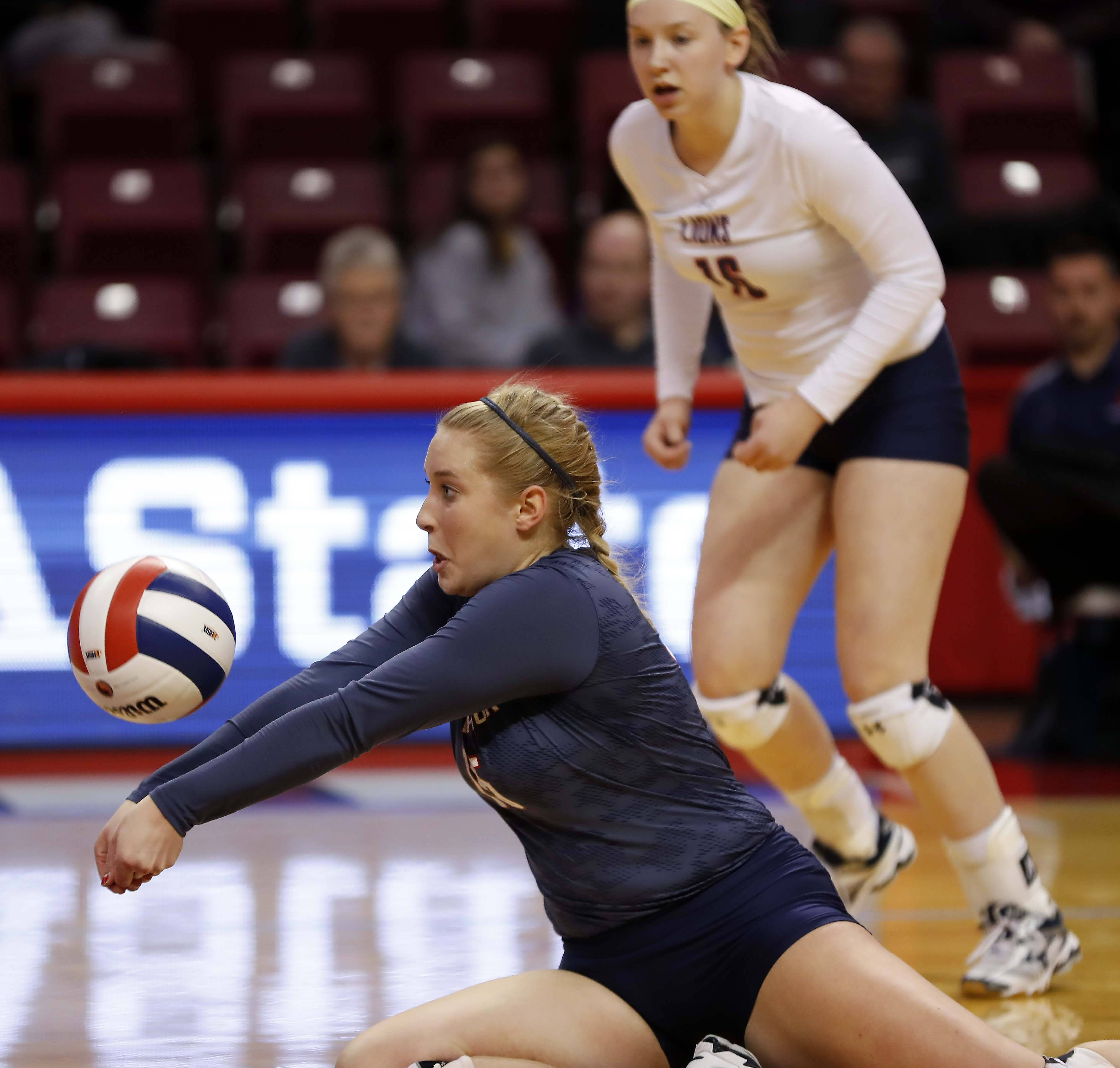 St. Viator's Carrie Leazer (15) with a dig in the semifinals of the IHSA Class 3A state girls volleyball tournament at Redbird Arena in Normal.