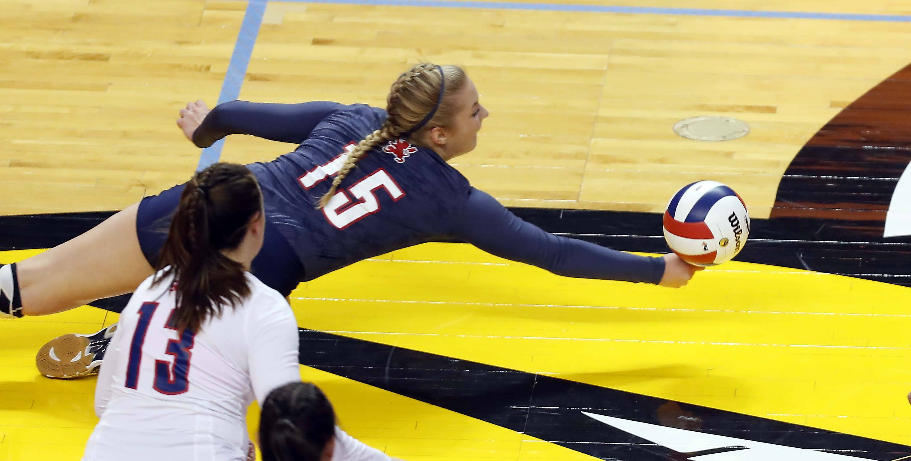 St. Viator's Carrie Leazer (15) with a huge dig in the semifinals of the IHSA Class 3A state girls volleyball tournament at Redbird Arena in Normal.