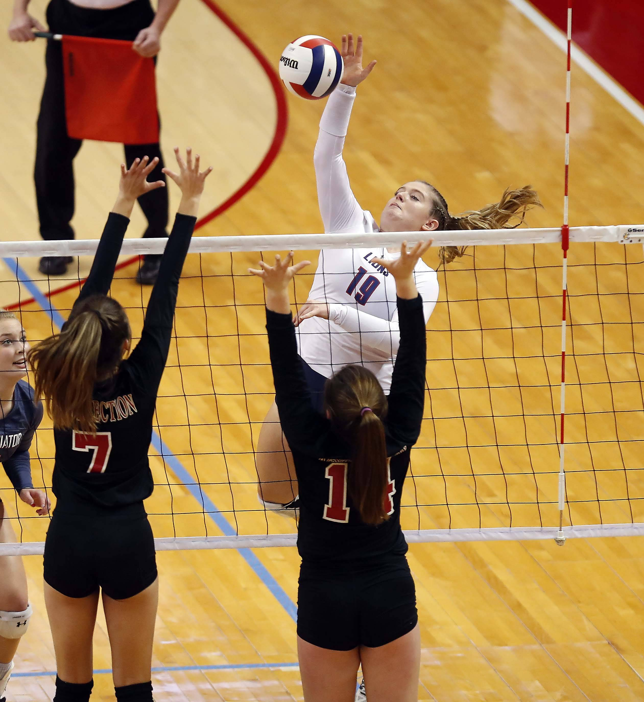 St. Viator's Kendall Claffey (19) in the semifinals of the IHSA Class 3A state girls volleyball tournament at Redbird Arena in Normal.