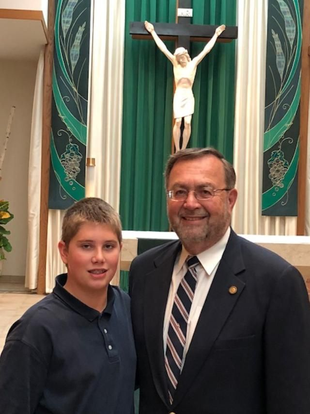 Dr. Walter Heinlein, DDS, and his grandson, Marco, at the Veterans Day Service at St. Theresa Church.