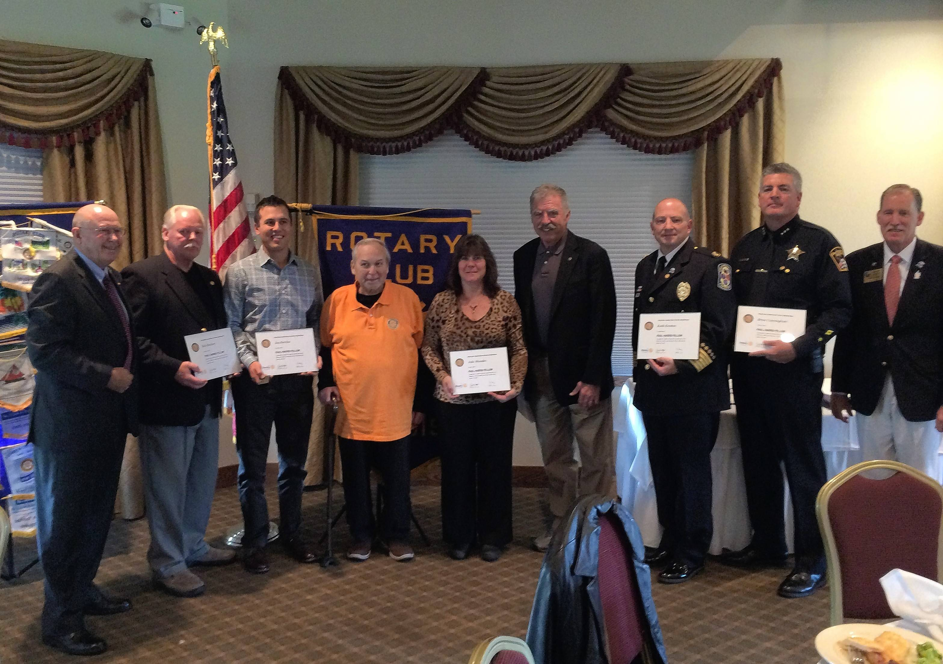 Pictured, from left, are Rich Moore, Rotarian; Bob Reichert of VFW 1578; Nick Perrino (accepting for father Nick) of Home Run Inn Pizza; Jack Briseno, president of Woodridge Rotary; Julie Rhodes, assistant superintendent, Woodridge Park District; John Perry, Rotarian; Keith Krestan, Lisle-Woodridge Fire Chief; Brian Cunningham, Woodridge Chief of Police; and Scott McAdam, Rotary District 6450 Governor.