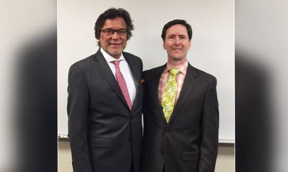 Faisal Rahman, Ph.D., left, Acting Dean of Graham School of Management and Assistant Professor David Parker, J.D.