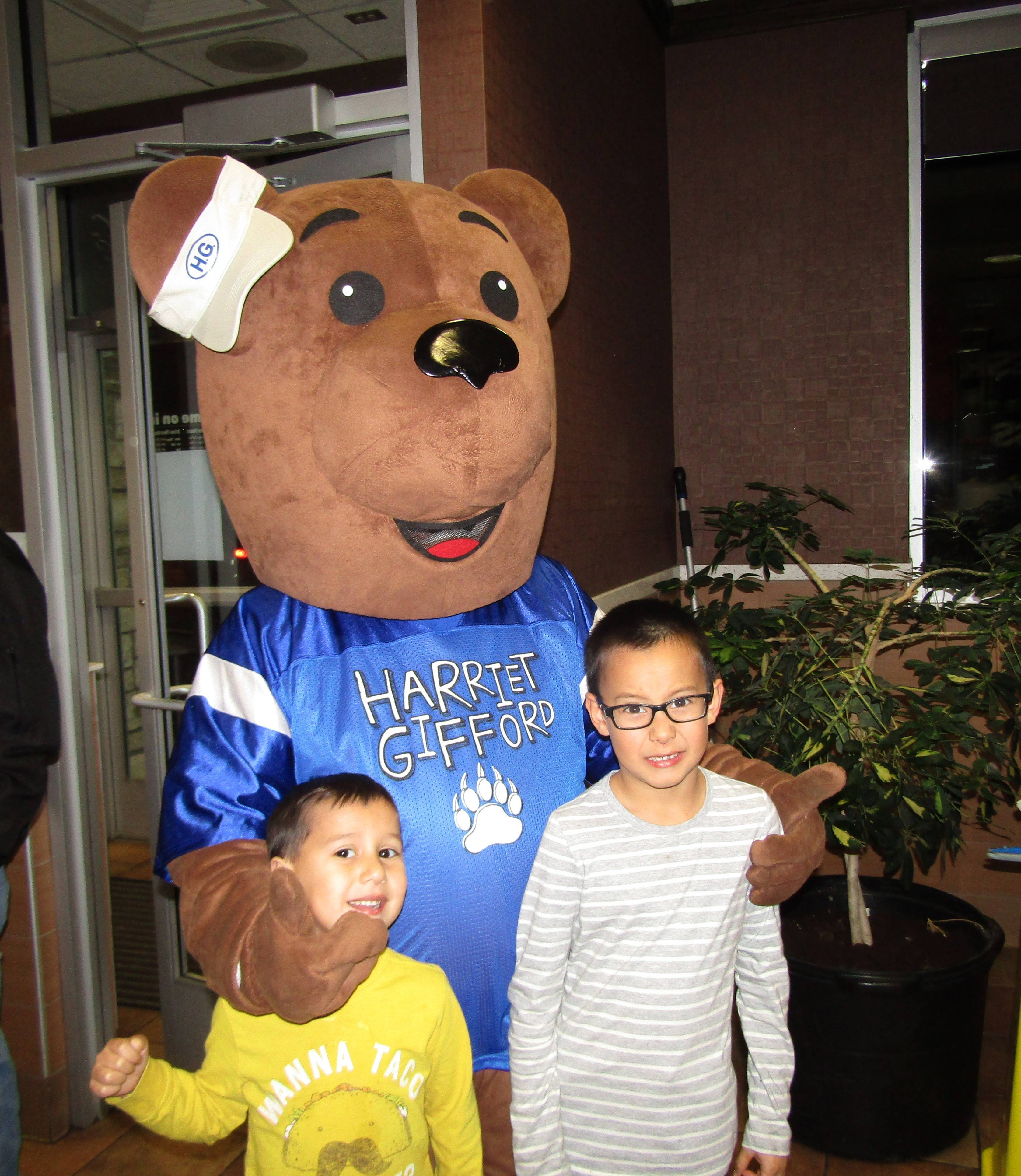"Christian and Anthony Picasso are thrilled to see the Harriet Gifford Elementary School mascot ""Buddy"" at a recent McTeacher's Night."