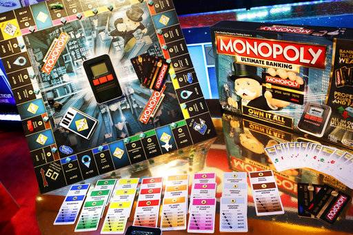 FILE - In this Monday, Feb. 15, 2016, file photo, the Monopoly Ultimate Banking Game from Hasbro is displayed at Toy Fair in New York. Shares of Mattel soared in after-hours trading Friday, Nov. 10, 2017, after a report that rival Hasbro has made a takeover offer for Mattel. Such a deal could bring together well-known brands like Monopoly, Nerf, Barbie and Hot Wheels.