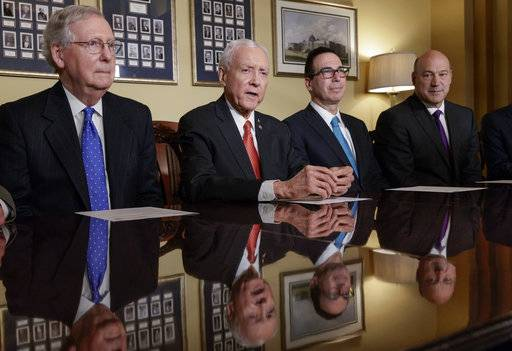 From left, Senate Majority Leader Mitch McConnell, R-Ky., Senate Finance Committee Chairman Orrin Hatch, R-Utah, Treasury Secretary Steven Mnuchin, and President Donald Trump's economic adviser Gary Cohn, make statements to reporters as work gets underway on the Senate's version of the GOP tax reform bill, on Capitol Hill in Washington, Thursday, Nov. 9, 2017. (AP Photo/J. Scott Applewhite)