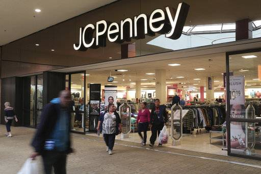 FILE - In this Friday, March 17, 2017, file photo, shoppers exit a J.C. Penney store in the Georgia Square Mall in Athens, Ga. J.C. Penney Co. Inc. reports earnings Friday, Nov. 10, 2017. (John Roark/Athens Banner-Herald via AP, File)