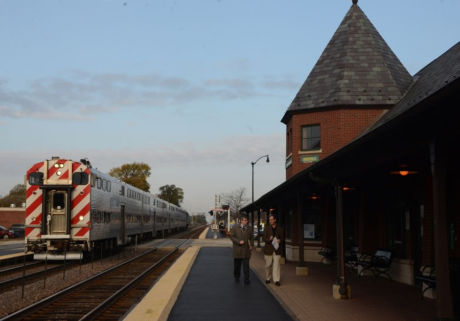 A Chicago-bound Metra express train rolls through the Arlington Heights station. The Metra board voted Friday to increase fares up to 12.6 percent.