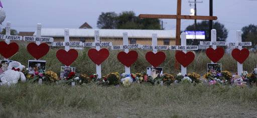 Crosses for members of the Holcombe family are part of a makeshift memorial for the victims of the church shooting at Sutherland Springs Baptist Church placed along the highway , Friday, Nov. 10, 2017, in Sutherland Springs, Texas. A man opened fire inside the church in the small South Texas community on Sunday, killing more than two dozen.