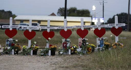 Crosses showing the names of shooting victims at the First Baptist Church of Sutherland Springs Baptist Church are part of a makeshift memorial placed along the highway , Friday, Nov. 10, 2017, in Sutherland Springs, Texas. A man opened fire inside the church in the small South Texas community on Nov. 5,  killing more than two dozen.