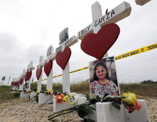Crosses showing shooting victims names stand near the First Baptist Church on Thursday, Nov. 9, 2017, in Sutherland Springs, Texas. A man opened fire inside the church in the small South Texas community on Sunday, killing more than two dozen and injuring others.