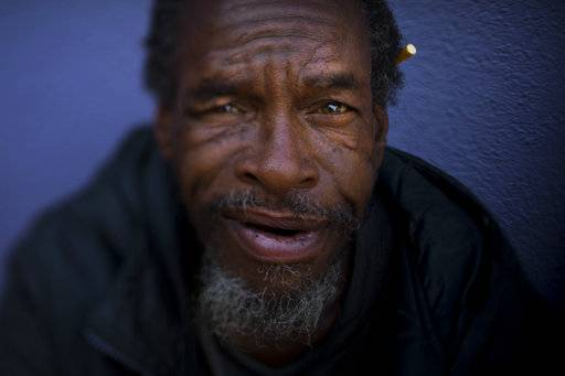 "Moi Williams, 59, poses for a photo Wednesday, Sept. 13, 2017, in Los Angeles. Williams, who has been homeless for four years, said he is comfortable sleeping on the street. ""I'm not bothering nobody. I'm not being bothered."" The homeless are easy to pass by on the street. It's harder when you look into their eyes. Their gazes hint at lost promise or a glimmer of hope. Some are sad, some placid, others haunting. Behind each person is a story that however vague offers some glimpse into their lives."