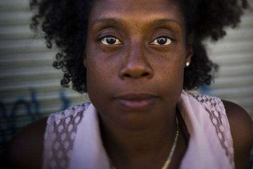 "Dolores Epps, 41, poses for a photo Thursday, Oct. 26, 2017, in Los Angeles. Epps, a mother of two children who has been homeless for five years, once had a job at a salon and still makes money cutting hair. ""I don't touch everybody, only the people that are clean,"" Epps said. ""All these dope fiends are gonna keep looking like a dope fiend. You're not my problem. But if you're a clean person and you just want to get a little bit extra sassy or as a man look a little more handsome, then yeah."" Her mother has custody of her 15-year-old daughter and 9-year-old son."