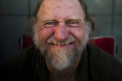 Barry Warren, 52, poses for a photo Wednesday, Sept. 27, 2017, in Seattle. Warren says he has been homeless his entire adult life. After about 20 years without a home in California, he moved to Seattle, where he says the benefits are better and life on the street is safer.