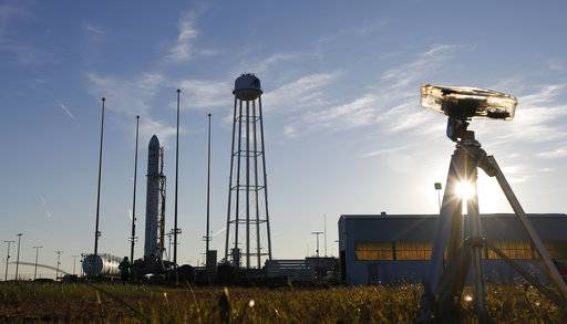 Orbital ATK's Antares rocket sits on the 0A launch pad at the NASA Wallops Island flight facility in Wallops Island, Va., Friday, Nov. 10, 2017. The rocket is carrying cargo to the International Space Station and is set to launch Saturday morning. (AP Photo/Steve Helber)