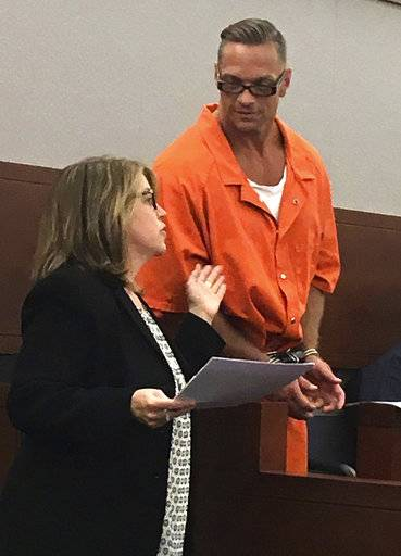 FILE - In this Aug. 17, 2017, file photo, Nevada death row inmate Scott Dozier, right, confers with Lori Teicher, a federal public defender involved in his case, during an appearance in Clark County District Court in Las Vegas. Nevada officials are pressing toward the state's first execution in 11 years, naming the state's top psychiatrist as interim replacement for the anesthesiologist who resigned last week after signing off on a lethal injection plan. Jordan Smith, of the state attorney general's office, told a judge Monday, Nov. 6, 2017, in Las Vegas that Dr. Leon Ravin has replaced Dr. John DiMuro as the state's top doctor. That makes Ravin the medical official with primary responsibility for next week's scheduled execution of twice-convicted murderer Dozier.