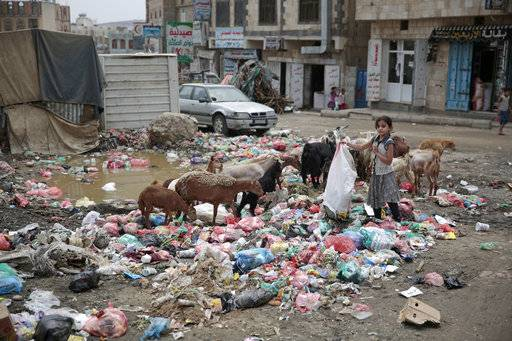 "FILE - In this Jul. 26, 2017 file photo, a girl scavenges at a garbage dump in a street in Sanaa, Yemen. The United Nations and more than 20 aid groups said Thursday, Nov. 9, 2017, that the Saudi-led coalition's tightening of a blockade on war-torn Yemen could bring millions of people closer to ""starvation and death."" About two-thirds of Yemen's population relies on imported supplies, said the groups, which include CARE, Save the Children and Islamic Relief."