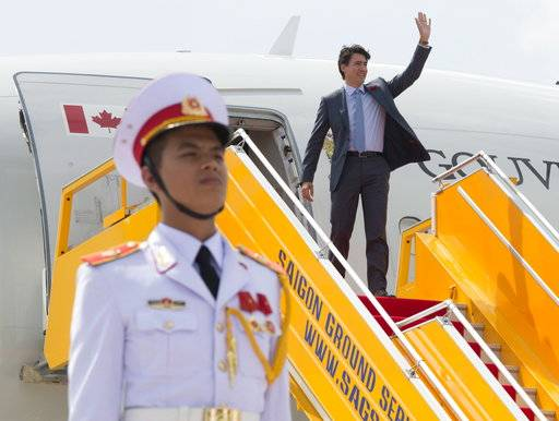 Canadian Prime Minister Justin Trudeau arrives in Da Nang, Vietnam, for the APEC summit Friday, Nov. 10, 2017.  (Adrian Wyld/The Canadian Press via AP)
