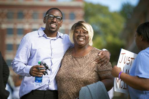 FILE - In this Oct. 13, 2017, file photo, Lamonte McIntyre, who was imprisoned for 23 years for a 1994 double murder in Kansas that he always said he didn't commit, walks out of a courthouse in Kansas City, Kan., with his mother, Rosie McIntyre, after Wyandotte County District Attorney Mark A. Dupree, Sr. dropped the charges. Dupree is establishing a conviction integrity unit within his office. That is essentially a watchdog that works to prevent, identify and correct false convictions. (Tammy Ljungblad /The Kansas City Star via AP, File)