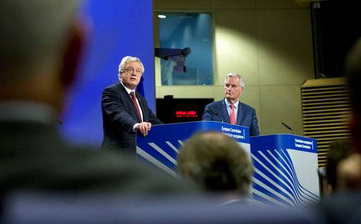 European Union chief Brexit negotiator Michel Barnier, right, and British Secretary of State for Exiting the European Union David Davis participate in a media conference at EU headquarters in Brussels on Friday, Nov. 10, 2017. The EU and Britain conducted a sixth round of Brexit negotiations on Friday.