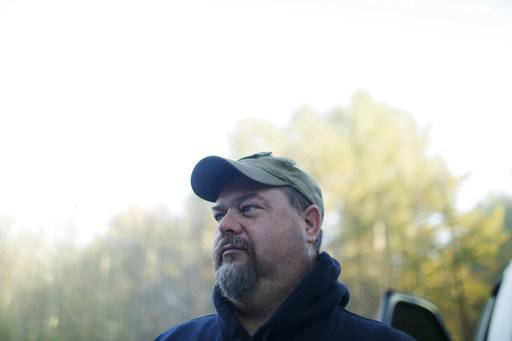 "Chris Hopper, 45, Altoona, Ala., talks with the Associated Press about Alabama Senator candidate Roy Moore, Friday, Nov. 10, 2017, in Altoona, Ala. Hopper, a neighbor of Moore, says, ""why not vote for somebody that's got good Christian values. The world is going to hell in a hand basket, I was raised Southern Baptist and the way things are going now a days its just terrible, the allegations with Roy, its mud slinging at its best."""