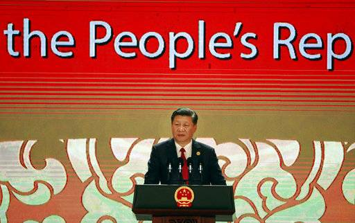 China's President Xi Jinping speaks on the final day of the APEC CEO Summit ahead of the Asia-Pacific Economic Cooperation (APEC) leaders summit in Danang, Vietnam, Friday, Nov. 10, 2017. (Nyein Chan Naing/Pool Photo via AP)