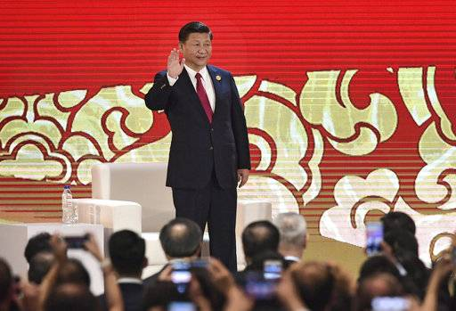 China's President Xi Jinping arrives to speak on the final day of the APEC CEO Summit, part of the broader Asia-Pacific Economic Cooperation (APEC) leaders' summit, in Danang, Vietnam, Friday, Nov. 10, 2017. (Anthony Wallace/Pool Photo via AP)