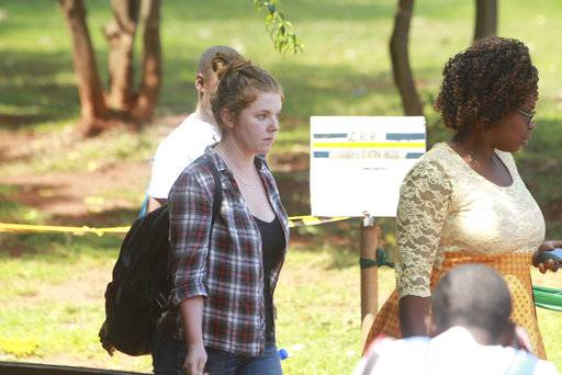 "U.S. Citizen Martha O' Donovan, center, appears at the Harare Magistrates court in Harare, Saturday, November, 4, 2017. Police arrested and charged Donavan with subversion for allegedly insulting President Robert Mugabe on Twitter as a ""sick man,"" lawyers said Friday. The offense carries up to 20 years in prison."