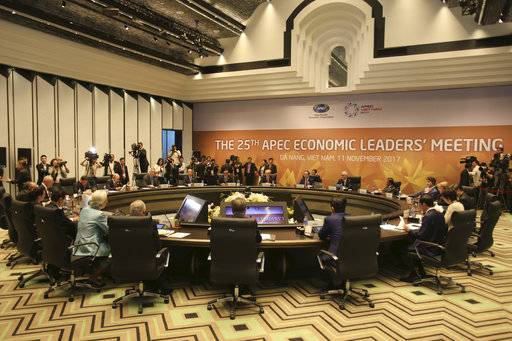Leaders attend the APEC economic leaders meeting in Danang, Vietnam, Saturday, Nov. 11, 2017. Seen facing camera from left to right: are Peru's President Pedro Pablo Kuczynski; Philippines President Rodrigo Duterte; Russian President Vladimir Putin; Singapore Prime Minister Lee Hsien Loong; Taiwan representative James Soong; Thailand Prime Minister Prayuth Chan-ocha; U.S. President Donald Trump; Vietnam's President Tran Dai Quang; Australia's Prime Minister Malcolm Turnbull; Brunei Sultan Hassanal Bolkiah; Canada Prime Minister Justin Trudeau; Chile's President Michelle Bachelet.