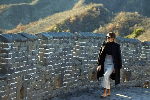 U.S. first lady Melania Trump walks along the Mutianyu Great Wall section in Beijing Friday, Nov. 10, 2017. Mrs. Trump toured China's famed Great Wall at Mutianyu, where she rode a cable car to a watchtower, signed a guestbook and strolled along a stretch of the wall for about half an hour with a small group of aides and security officers.