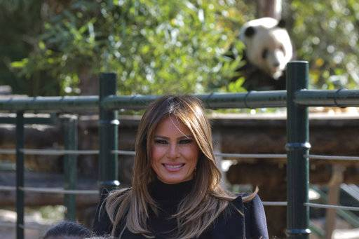 U.S. first lady Melania Trump poses for photos near the panda enclosure at a zoo in Beijing, China, Friday, Nov. 10, 2017.